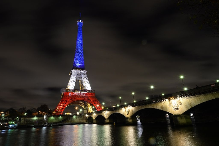 Top: The Eiffel Tower is bathed in the red, white and blue of the French flag after the terrorist attacks of Nov. 13. (Bertrand Guay/AFP/Getty Images)