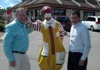 Ripon McDonald's restaurant owner Jack King, left, and manager Vince King pose with a Ronald McDonald statue outside the restaurant July 9, 2014. The statue was returned after being missing for several months. (WLUK/Eric Peterson)