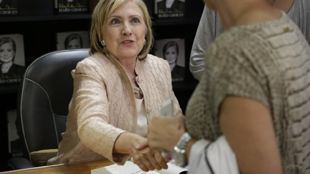 "Former Secretary of State Hillary Rodham Clinton shakes hands with a customer at Bunch of Grapes Bookstore, in Vineyard Haven, Mass., on the island of Martha's Vineyard, Wednesday, Aug. 13, 2014, during a book signing event for her memoir ""Hard Choices."" (AP Photo/Steven Senne)"