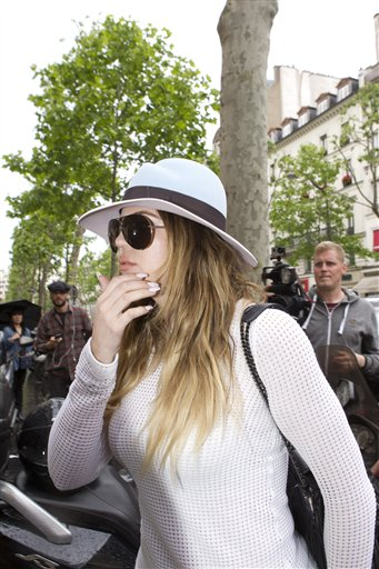 Khloe Kardashian, sister of Kim Kardashian, arrives at Kanye West's Paris apartment, Tuesday, May 20, 2014.