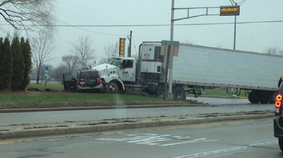 A semi collided with a sports utility vehicle in Grand Chute on Tuesday, April 29, 2014. (ReportIt/Tyler Schwab)