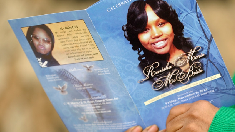 In this Nov. 8, 2013 photo, Karen Powell, aunt of Renisha McBride, holds a program at the funeral for McBride in Detroit. (AP Photo/Detroit News, Todd McInturf)
