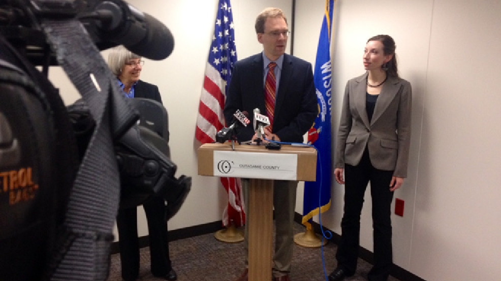Outagamie County Executive Tom Nelson introduces interim emergency management director Christina Muller (right), April 30, 2014, at the county administration building in Appleton. (WLUK/Bill Miston)