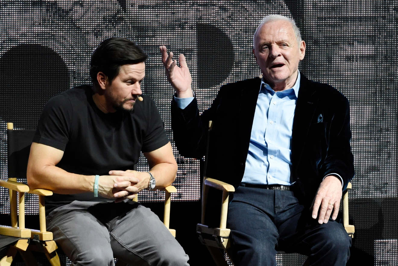 "Anthony Hopkins, right, a cast member in ""Transformers: The Last Knight,"" addresses the audience as fellow cast member Mark Wahlberg looks on during the Paramount Pictures presentation at CinemaCon 2017 at Caesars Palace on Tuesday, March 28, 2017, in Las Vegas. (Photo by Chris Pizzello/Invision/AP)"