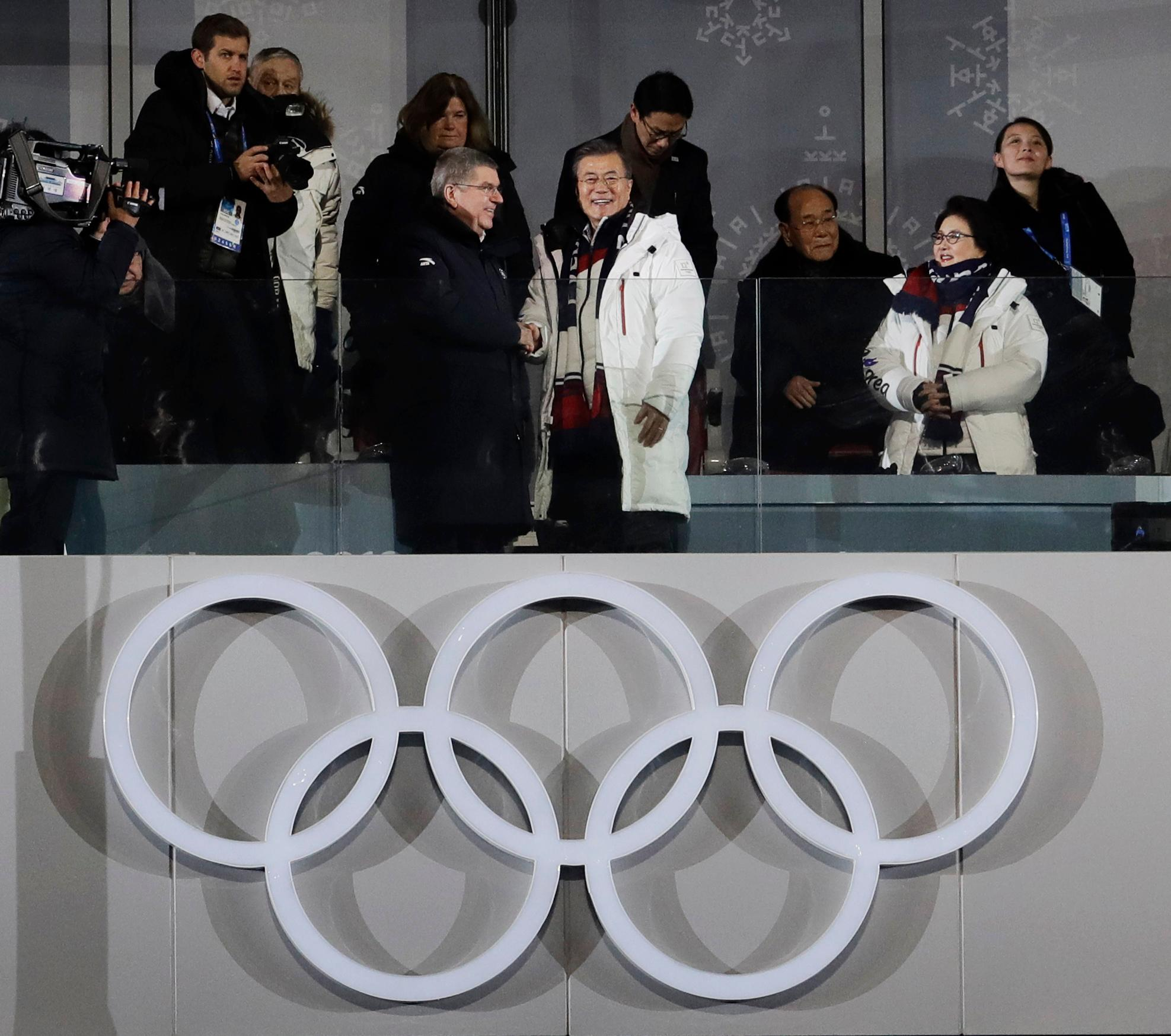 International Olympic Committee President Thomas Bach, left, shakes hands with South Korean President Moon Jae-in as his wife Kim Jung-sook stands second from right near Kim Yo Jong, far right, sister of North Korean leader Kim Jong Un, and Kim Yong Nam, North Korea's nominal head of state, third from right, during the opening ceremony of the 2018 Winter Olympics in Pyeongchang, South Korea, Friday, Feb. 9, 2018. (AP Photo/Petr David Josek)