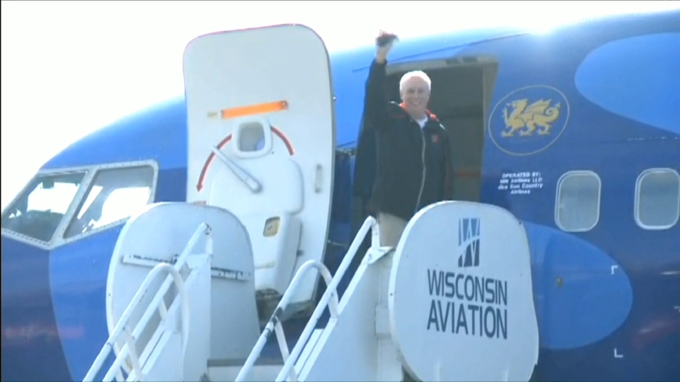 Wisconsin Badgers head coach Bo Ryan waves to the media as he boards a plane.  Wisconsin left for the Final Four in Dallas, Texas on Wednesday.