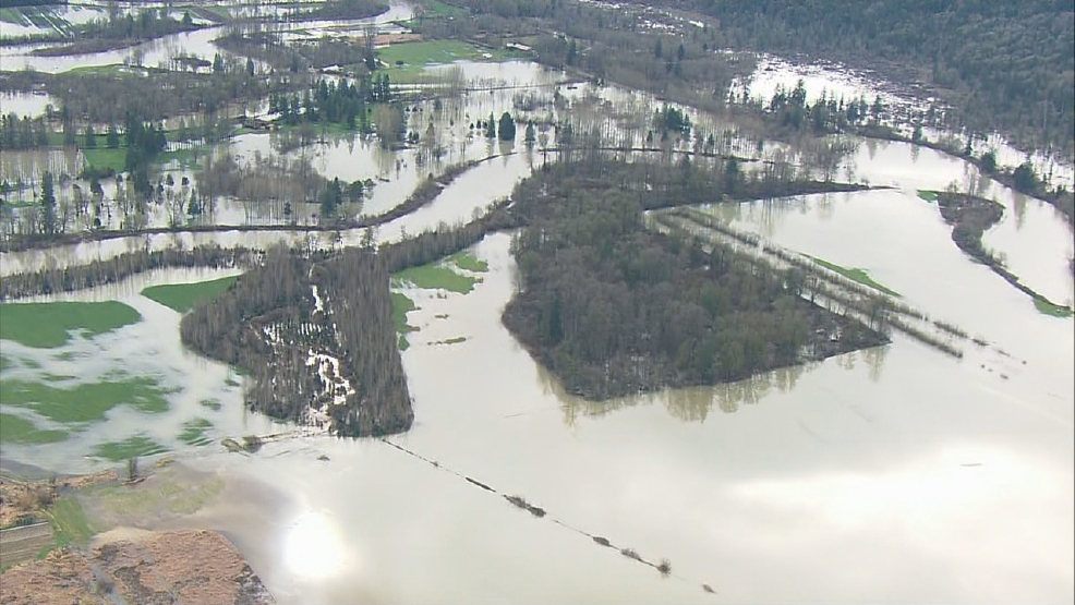 Flood-gorged rivers swamp roads in King, Snohomish counties