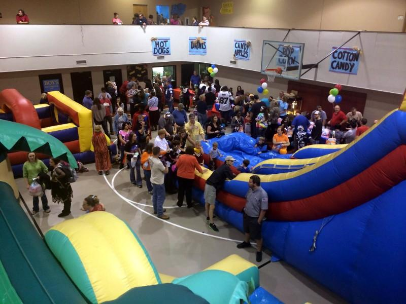 Families fill the indoor Fall Festival at First Baptist Church of Pinson Halloween night.