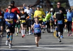 Mobility-impared runners David Abel, left, Juli Windsor, and Scott Rigsby compete in the 118th Boston Marathon Monday, April 21, 2014 in Hopkinton, Mass. (AP Photo/Michael Dwyer)