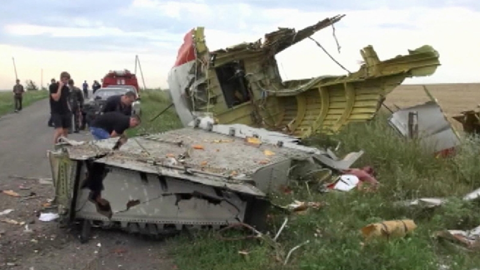 In this image taken from video, Thursday July 17, 2014, showing part of the wreckage of a passenger plane carrying 295 people after it was shot down Thursday as it flew over Ukraine, near the village of Hrabove, in eastern Ukraine. Malaysia Airlines tweeted that it lost contact with one of its flights as it was traveling from Amsterdam to Kuala Lumpur over Ukrainian airspace. (AP Photo / Channel 1)