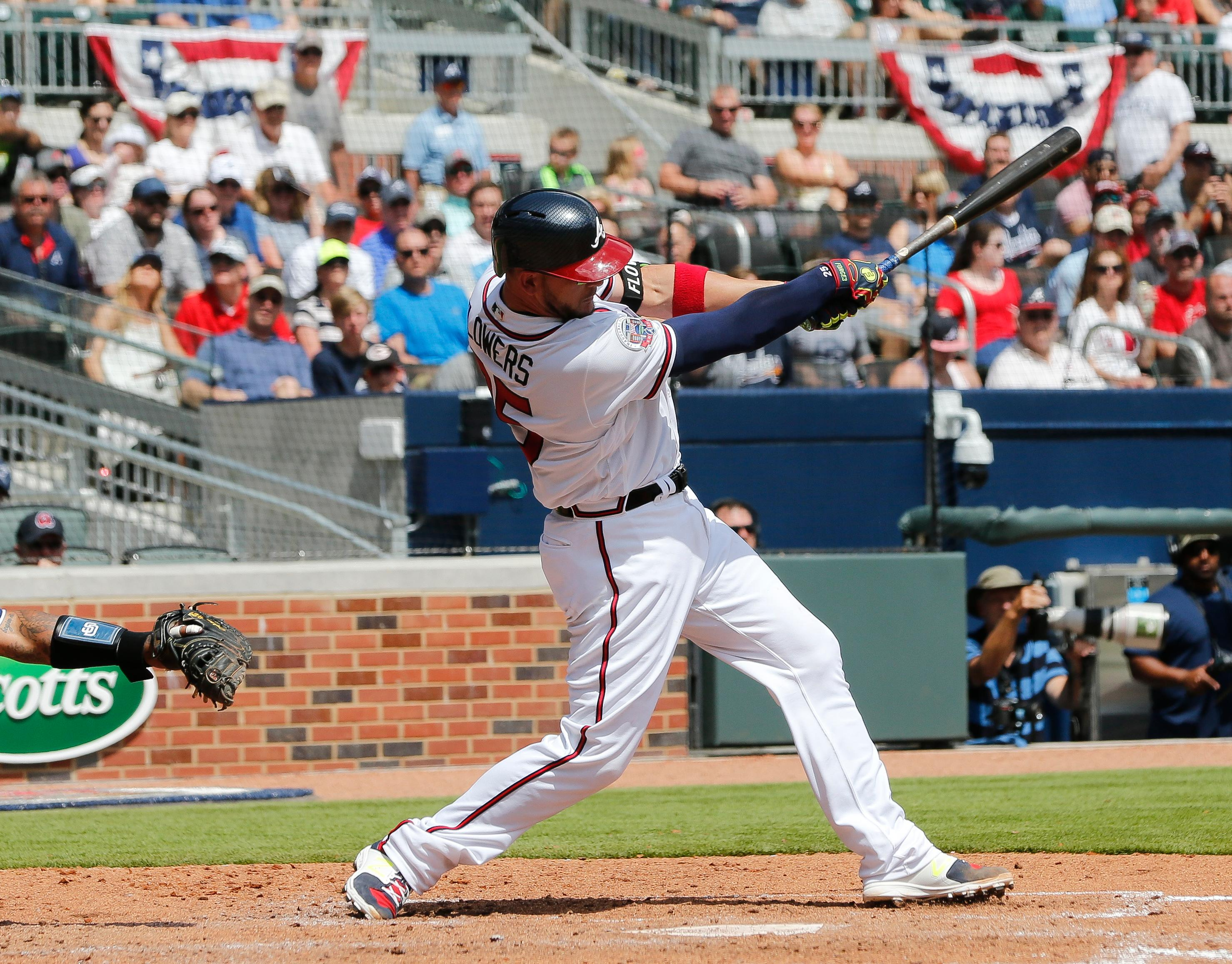 Atlanta Braves catcher Tyler Flowers follows through on a two-run single in the fifth inning of a baseball game against the San Diego Padres Sunday, April 16, 2017, in Atlanta. (AP Photo/John Bazemore)