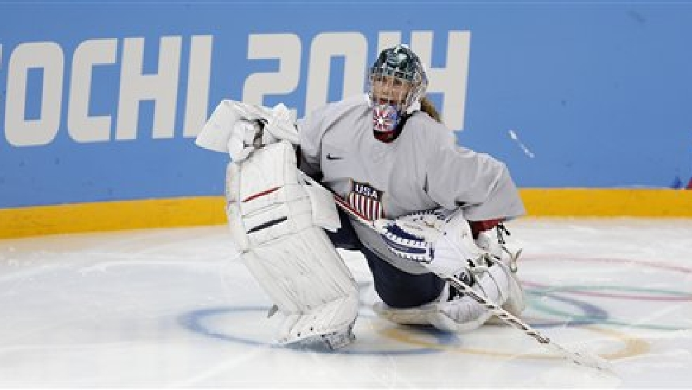 Jessie Vetter, goalkeeper of the U.S. women's ice hockey team, stretches during a practice session ahead of the 2014 Winter Olympics, Thursday, Feb. 6, 2014, in Sochi, Russia. (AP Photo/Petr David Josek)