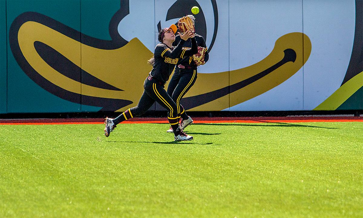 The Sun Devils' Skylar McCarty (#1) makes the catch in the outfield under the watchful gaze of the Duck. The Oregon Ducks Softball team took their third win over the Arizona Sun Devils, 1-0, in the final game of the weekends series that saw the game go into an eighth inning before the Duck?s Mia Camuso (#7) scored a hit allowing teammate Haley Cruse (#26) to run into home plate for a point. The Ducks are now 33-0 this season and will next play a double header against Portland State on Tuesday, April 4 at Jane Sanders Stadium. Photo by August Frank, Oregon News Lab