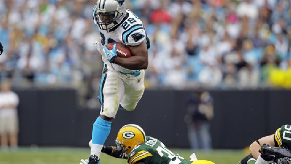 Carolina Panthers' Jonathan Stewart (28) jumps over Green Bay Packers' Nick Collins (36) during the second half of an NFL football game in Charlotte, N.C., Sunday, Sept. 18, 2011. (AP Photo/Gerry Broome)