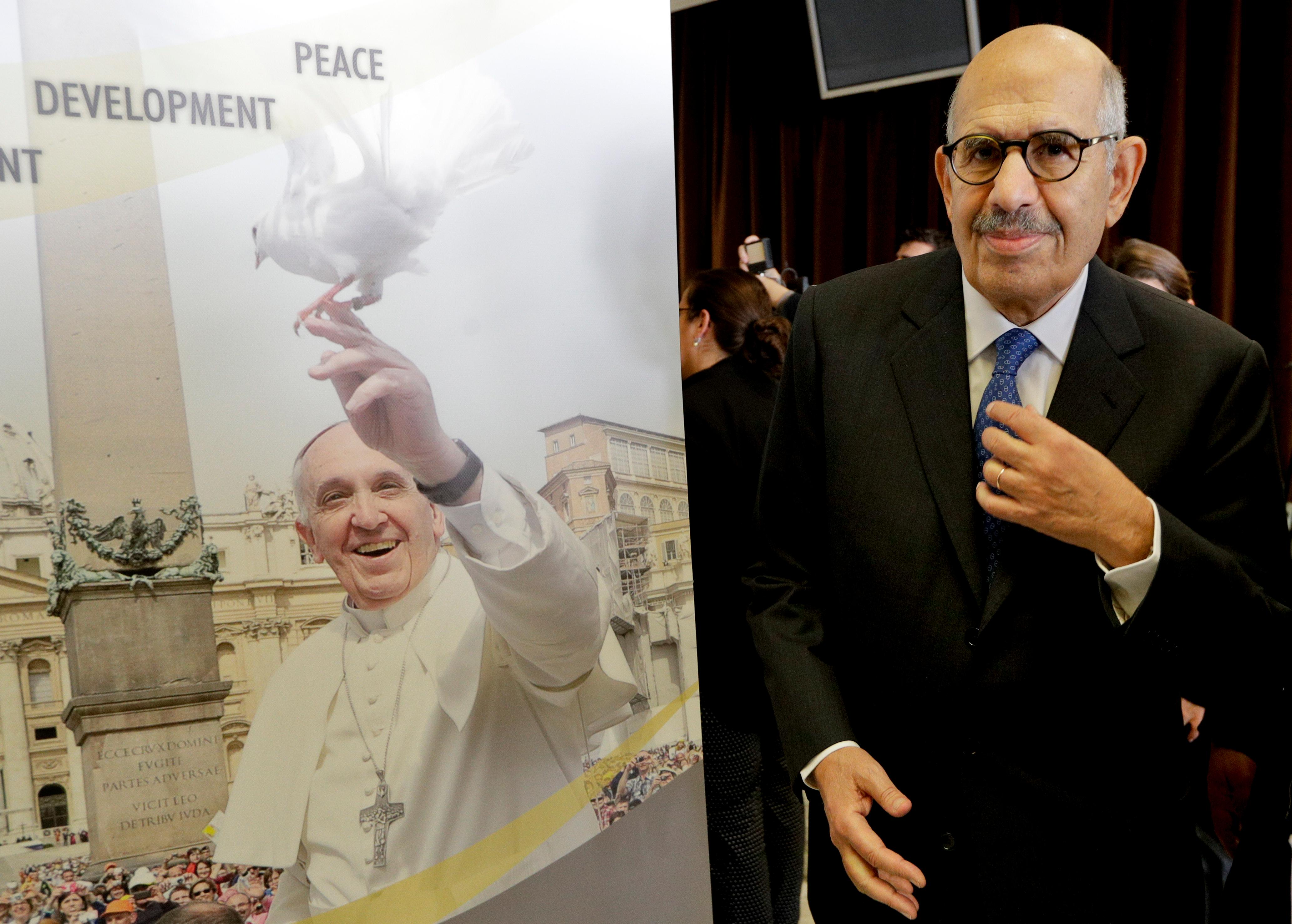 Director General Emeritus of the Intenational atomic Energy Agency and Nobel Peace laureate Mohamed ElBaradei poses for a picture next to a poster of Pope Francis as he arrives for interviews during a break in a conference on nuclear disarmament, at the Vatican, Friday, Nov. 10, 2017. The Vatican hosted Nobel laureates, U.N. and NATO officials and a handful of nuclear powers at a conference aimed at galvanizing support for a global shift from the Cold War era policy of nuclear deterrence to one of total nuclear disarmament.(AP Photo/Andrew Medichini3