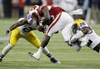 Wisconsin running back Melvin Gordon is tackled by LSU's Ronald Martin (26) and Jalen Mills (28) after running for a first down during the first half of an NCAA college football game Saturday, Aug. 30, 2014, in Houston. (AP Photo/David J. Phillip)