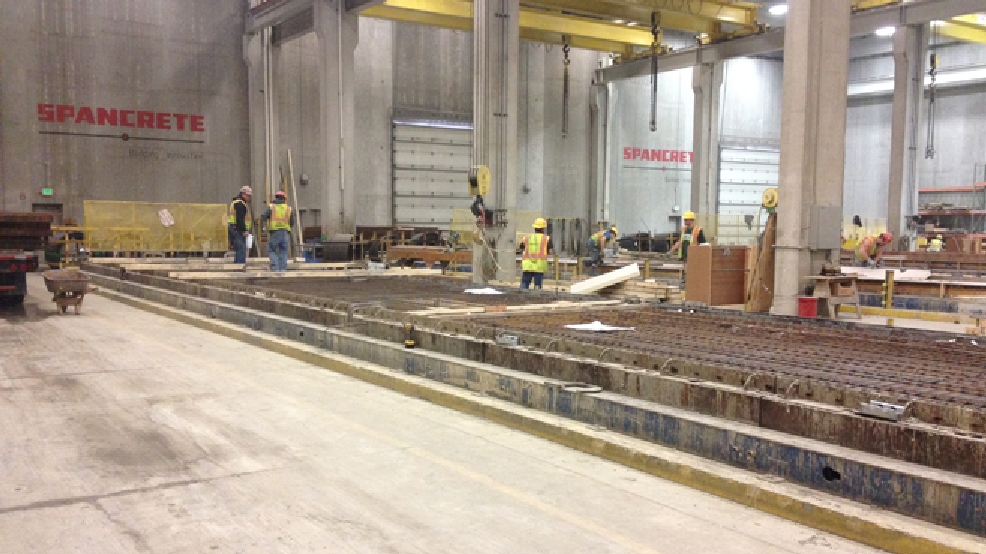Workers on the floor at Spancrete in Valders, Feb. 13, 2014. (WLUK/Bill Miston)