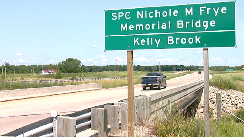 A sign identifying the Spc. Nichole M. Frye Memorial Bridge is posted along Hwy. 141 in Lena, July 18, 2014. (WLUK)