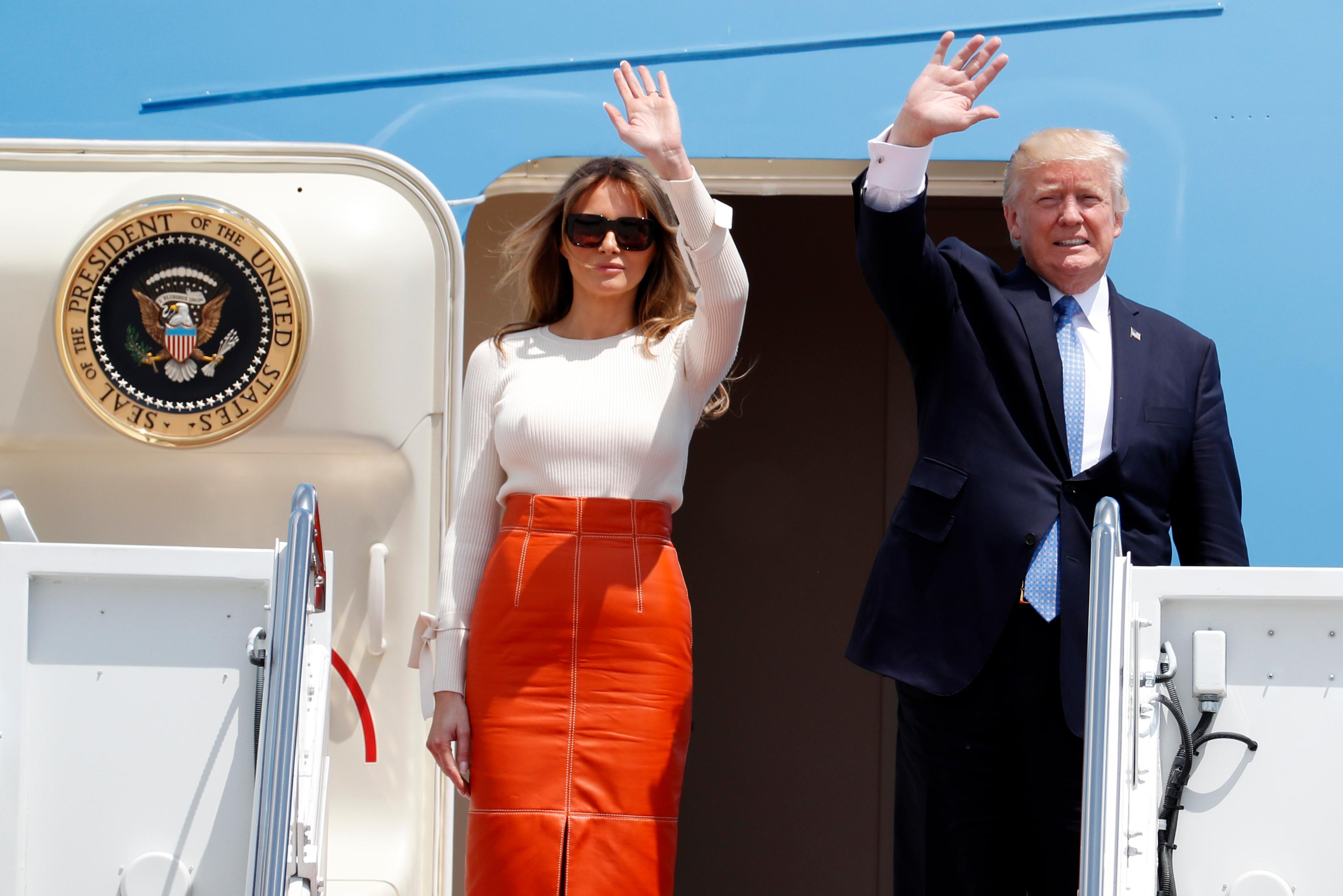 President Donald Trump and first lady Melania Trump, wave as they board Air Force One at Andrews Air Force Base, Md., Friday, May 19, 2017, prior to his departure on his first overseas trip. (AP Photo/Alex Brandon)