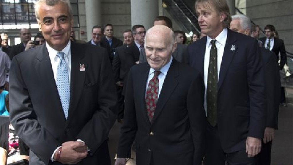 Milwaukee Bucks owner Herb Kohl walks into a news conference after reaching a deal to sell the franchise to New York investment firm executives Marc Lasry, left, and Wesley Edens, right, Wednesday, April 16, 2014, in Milwaukee. (AP Photo/Morry Gash)