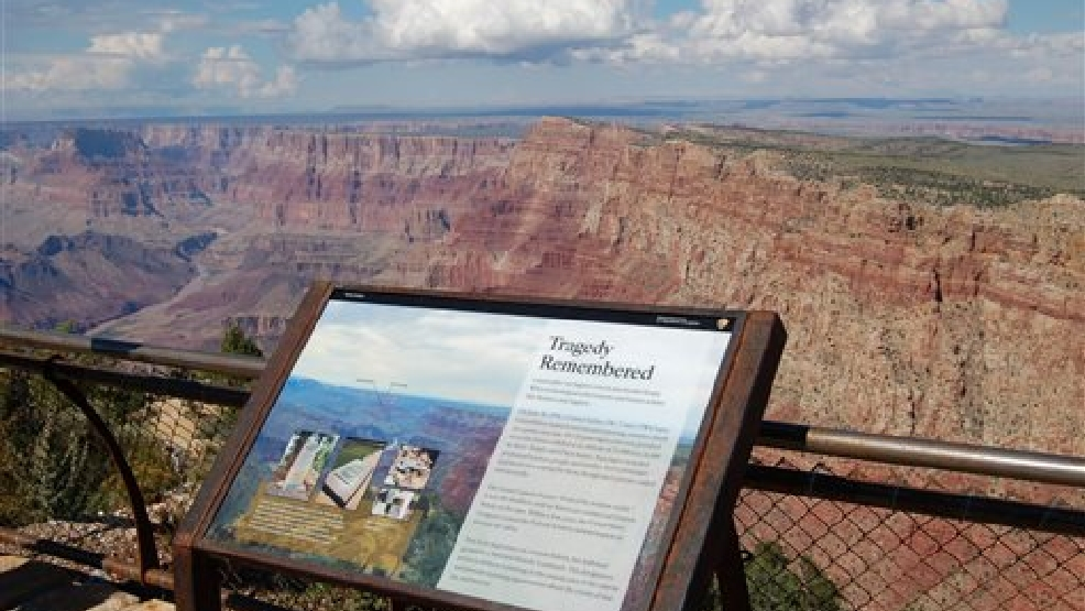 This Sept. 12, 2013 photo released by the Grand Canyon National Park Service, shows a National Historical Landmark plate overlooking the east end of the Grand Canyon, Ariz. Two commercial airplanes, United Flight 718 and TWA Flight 2 crashed on June 30, 1956 over the Grand Canyon, killing all 128 people aboard in one of the deadliest aviation disasters in the U.S. On Tuesday, July 8, 2014, the Grand Canyon National Park will mark the designation of the crash site as a National Historic Landmark in a ceremony overlooking the gorge where the wreckage was scattered over 1.5 square miles. (AP Photo/Grand Canyon National Park Service)