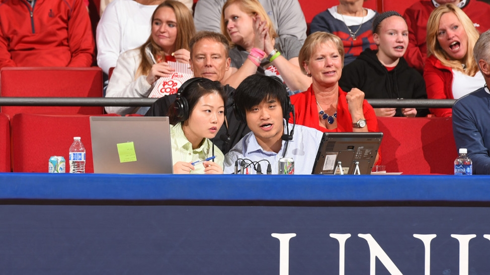 Xueyin Shi and Yiqing Zhou, students at Dayton, are two of the six students calling Flyers games in Mandarin this year. (Courtesy Dayton Athletics)