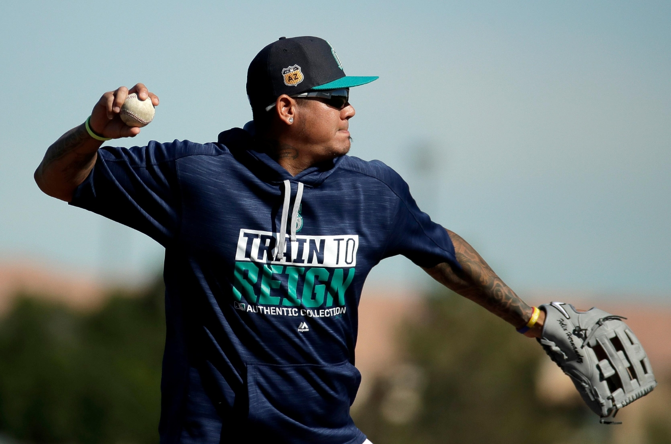 Seattle Mariners pitcher Felix Hernandez throws during spring training baseball practice, Tuesday, Feb. 21, 2017, in Peoria, Ariz. (AP Photo/Charlie Riedel)