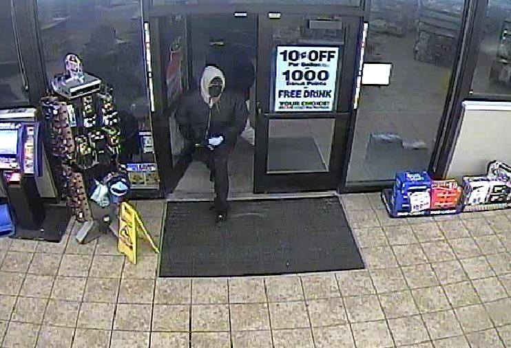 Police looking for two suspects in the robbery of the Speedway on South Linden Road. (Pictured from Flint Twp. Police)