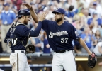 Milwaukee Brewers catcher Jonathan Lucroy and Francisco Rodriguez (57) celebrate their 4-3 over the Pittsburgh Pirates after a baseball game Sunday, Aug. 24, 2014, in Milwaukee. (AP Photo/Morry Gash)