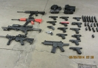Guns taken during a drug bust in Howard, March 25, 2014. (Brown Co. Drug Task Force)