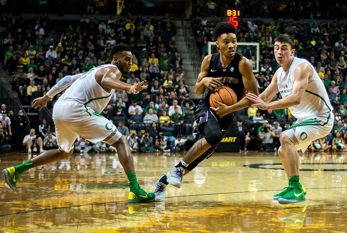 The Washington Huskies offense drives past the Oregon Ducks defense. The Oregon Ducks defeated the Washington Huskies 65-40 on Thursday night at Matthew Knight Arena. Troy Brown, Junior led Oregon with 21 points to match his career high, and Kenny Wooten set a career best of seven shots blocked. The Ducks now stand 6-5 in the Pac-12 conference play. Photo by Abigail Winn, Oregon News Lab
