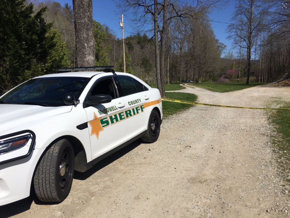 McDowell County sheriff's deputies are investigating after three people were found shot and killed in North Cove in what authorities call a double murder-suicide. (Photo credit: WLOS Staff)