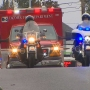 Police make solemn procession to escort slain Tacoma officer's body
