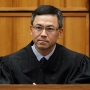 Judge in Hawaii extends order blocking Trump's travel ban