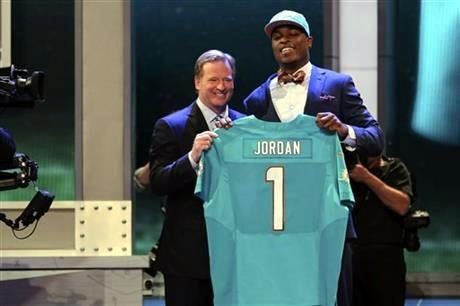 Dion Jordan, a defensive end from Oregon, stands with NFL Commissioner Roger Goodell after being selected third overall by the Miami Dolphins in the first round of the NFL football draft, Thursday night.