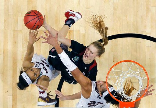 Stanford guard Brittany McPhee (12) battle for a rebound with South Carolina guard Allisha Gray (10) and forward A'ja Wilson (22) during the second half of an NCAA college basketball game in the semifinals of the women's Final Four, Friday, March 31, 2017, in Dallas. (AP Photo/Tony Gutierrez)