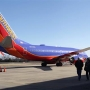 Southwest says technology outage fixed but more flights cut