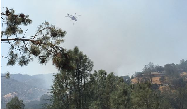 Helicopters are helping to battle the fire from the air. Photo provided by Glen Chesbrough on Saturday Aug. 5, 2017.