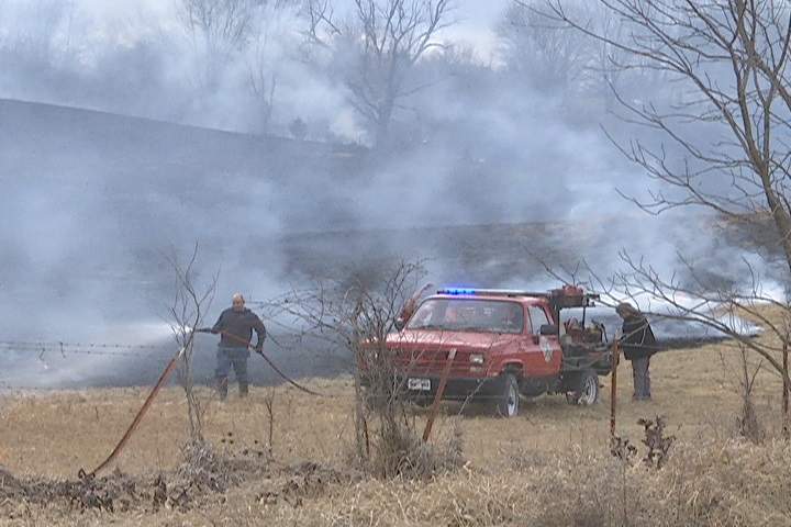 Firefighters work to put out fire Northeast of Kirksville (KTVO/Jacqueline Schutte)