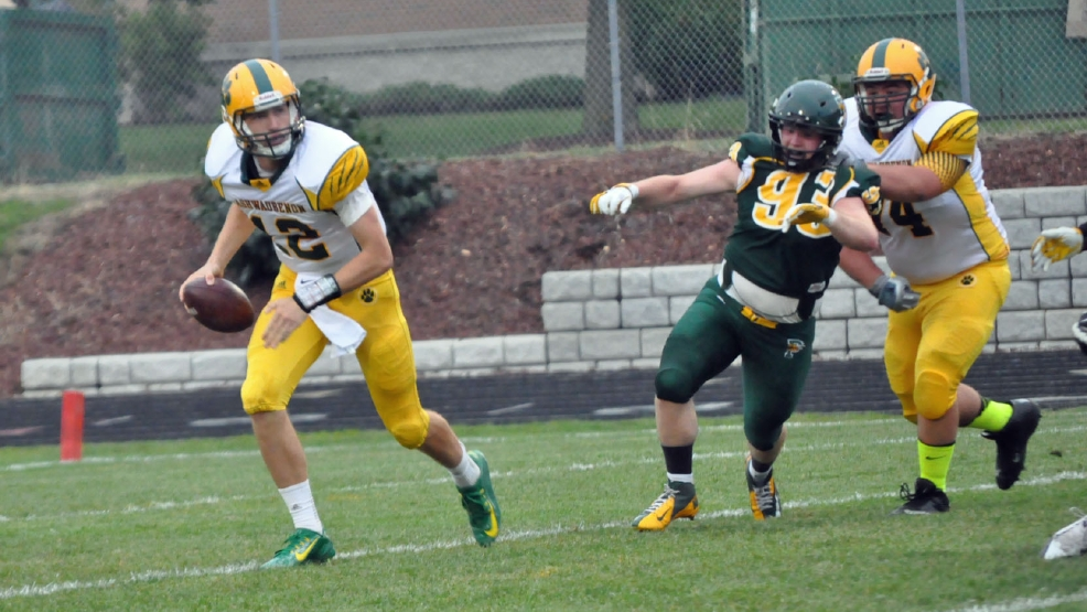 Ashwaubenon quarterback James Morgan scrambles from pressure during a Week 1 win over Green Bay Preble. (WLUK-TV)