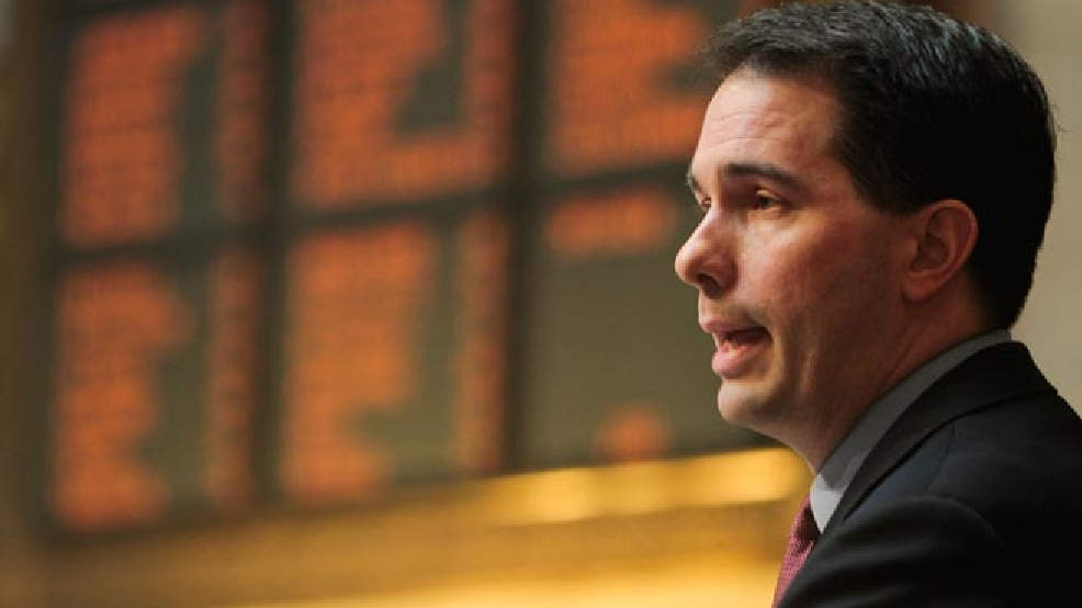 Wisconsin Gov. Scott Walker addresses a joint session of the Legislature at the state Capitol in Madison, Tuesday, March 1, 2011. Opponents to the governor's bill to eliminate collective bargaining rights for many state workers have been protesting the governor's budget for 14 days at the Capitol. (AP Photo/Andy Manis)