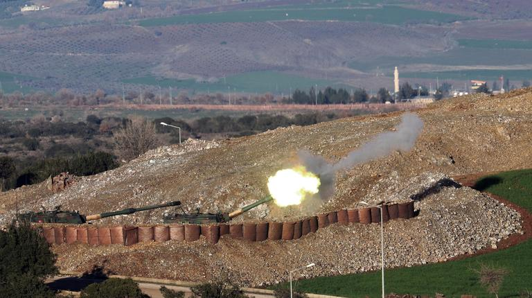 "In this photo taken Friday, Jan. 19, 2018, Turkish artillery fire toward Syrian Kurdish positions from the Turkish side of the border, in Hatay, southern Turkey. Turkey's President Recep Tayyip Erdogan repeated Saturday that a Turkish offensive against the Syrian Kurdish-controlled enclave of Afrin was ""de facto"" underway and said it would be followed by an operation against another Kurdish-held territory.(Nuri Pir/IHA via AP)"
