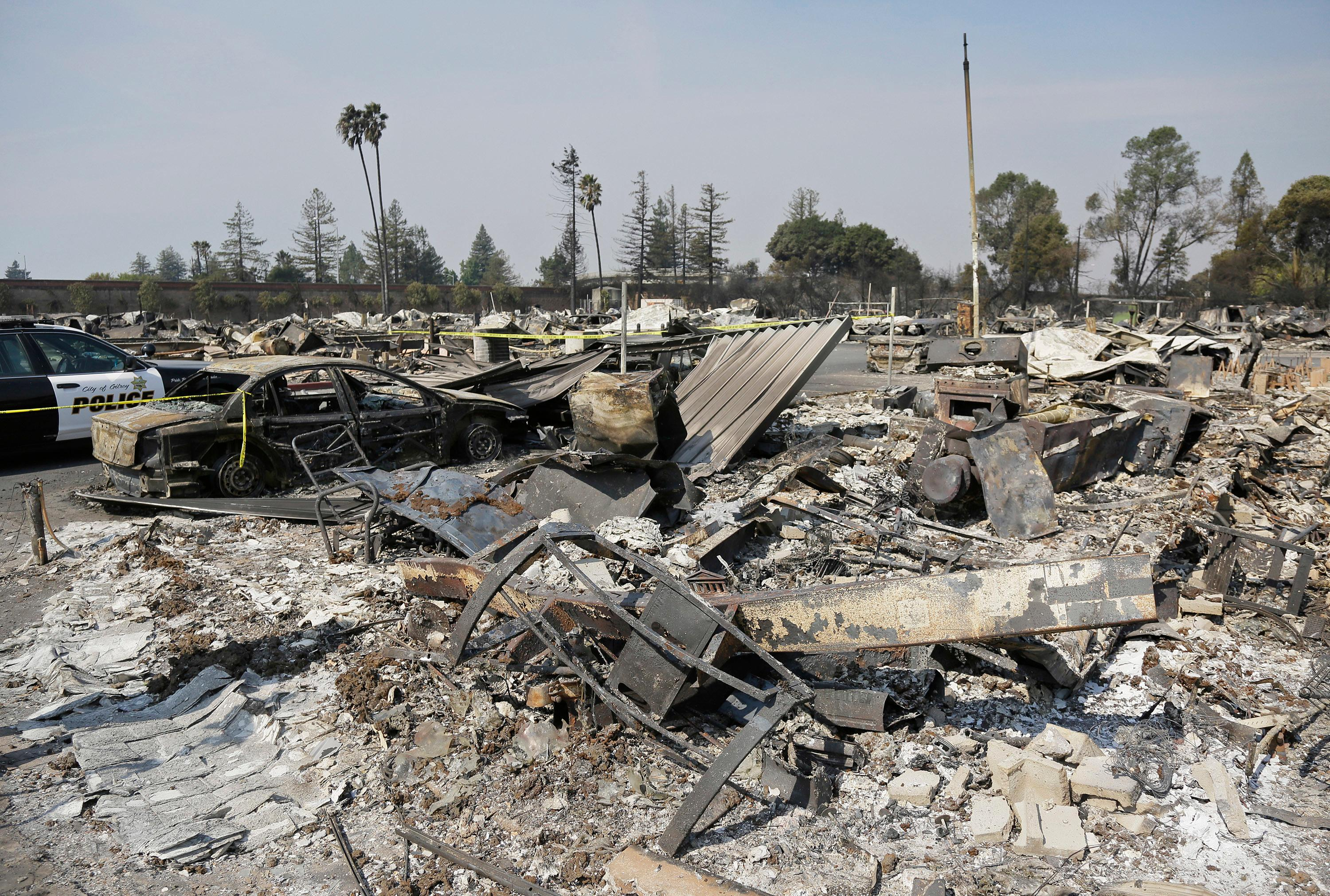 Shown are the remains of where Linda Tunis lived at the Journey's End mobile home park Wednesday, Oct. 11, 2017, in Santa Rosa, Calif. Jessica Tunis is searching for her missing mother, Linda Tunis, who was living at the mobile home park when the wildfires struck. (AP Photo/Eric Risberg)