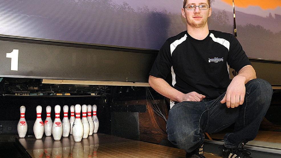 Andy Gardner, an employee of Wagner's Lanes, is pictured Feb. 10, 2014 in the Eau Claire bowling alley where he rescued a toddler who had been swept Feb. 9 into the pin setting apparatus at the end of a lane. The unidentified boy was uninjured after Gardner hit a switch that stopped the machinery. (AP Photo/Eau Claire Leader-Telegram, Steve Kinderman)