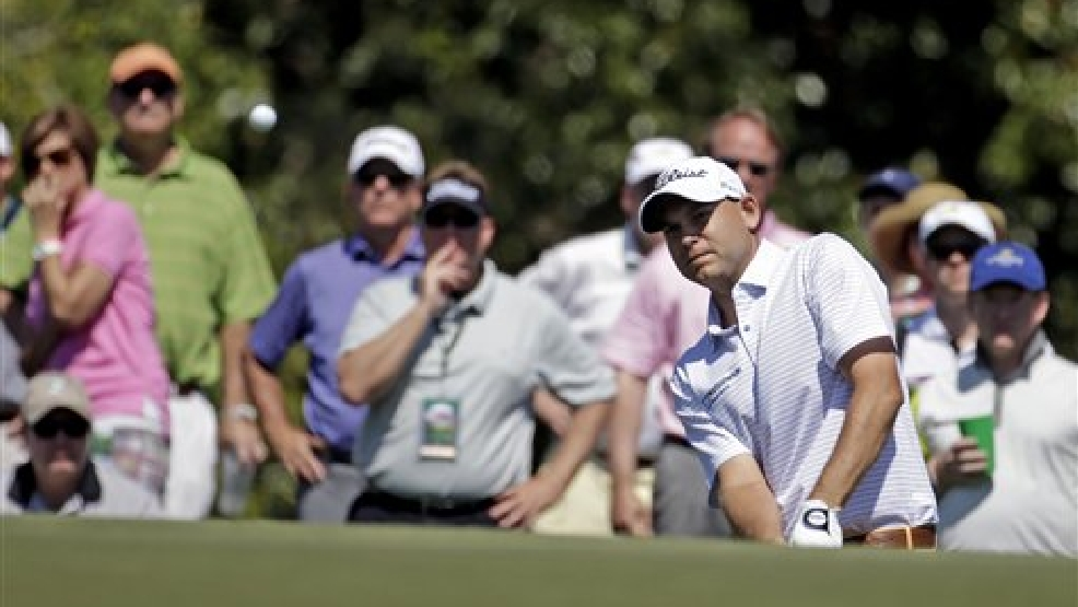 Bill Haas watches his chip shot to the 17th green during the first round of the Mast