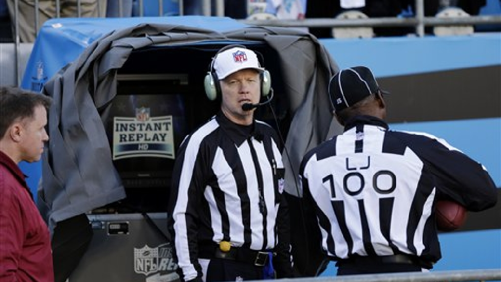 Officials watch an instant replay after a San Francisco 49ers touchdown against the Carolina Panthers during the first half of a divisional playoff NFL football game, Sunday, Jan. 12, 2014, in Charlotte, N.C. (AP Photo/Chuck Burton)