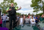 Police instruct family members on where to pickup students after a school shooting at Reynolds High School in Troutdale, Ore., on Tuesday, June 10, 2014. (AP Photo/The Oregonian, Thomas Boyd)