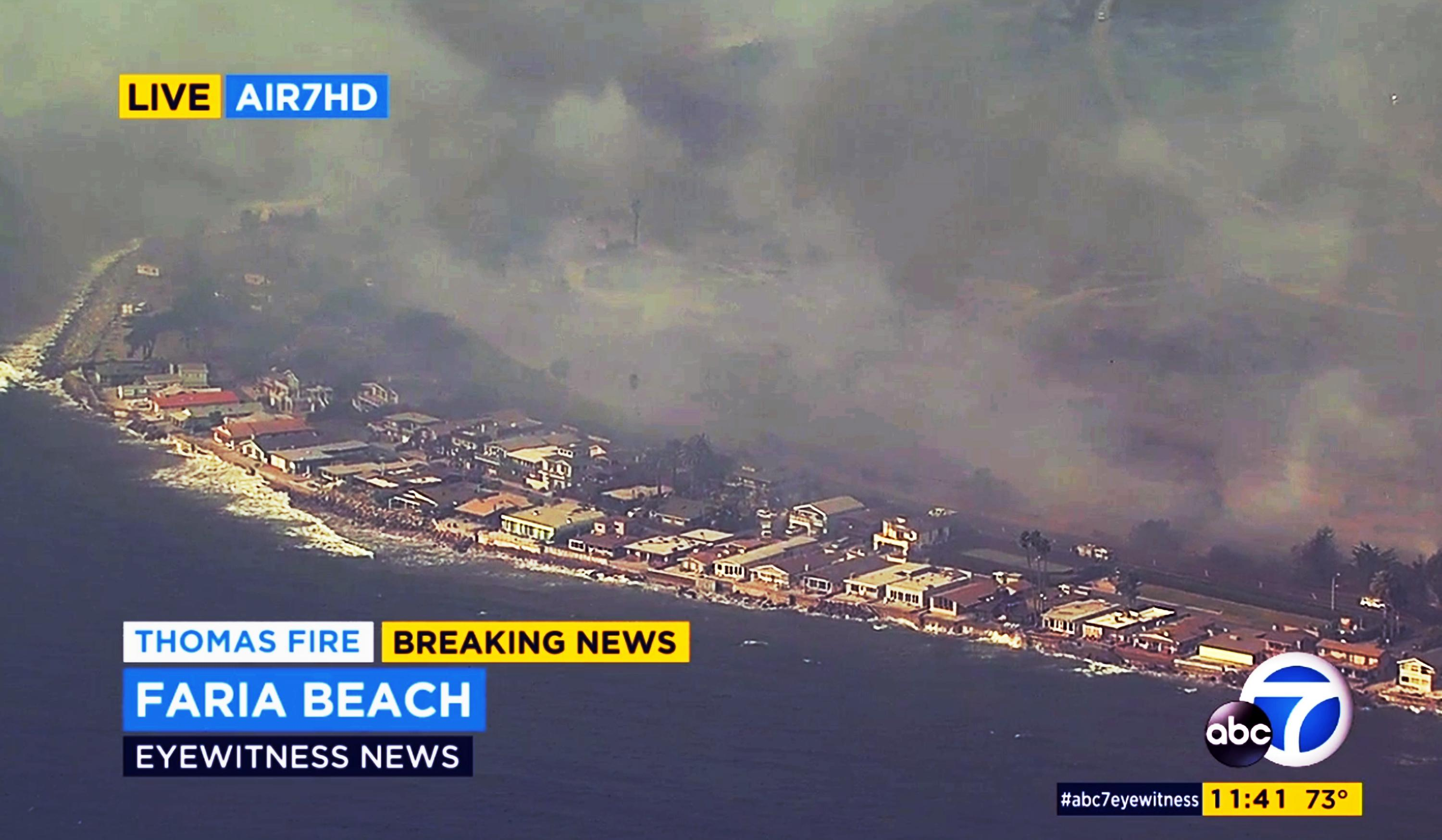 This aerial view from video provided by KABC-TV shows flames from a wildfire bearing down on homes on Faria Beach just outside Ventura, Calif., Thursday, Dec. 7, 2017. It appeared that firefighters were able to stop the flames before they overran the area. (KABC-TV via AP)