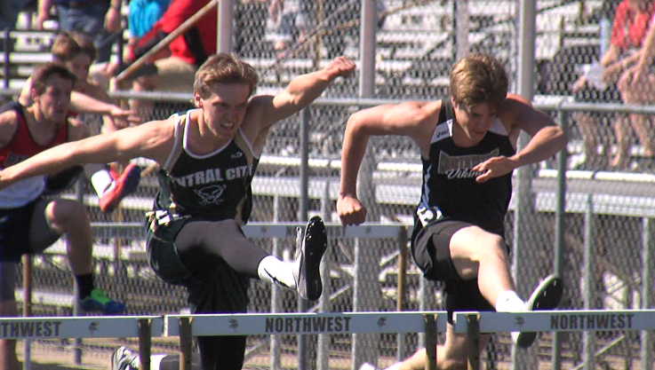 Vincent Ohlman (left) of Central City runs neck and neck with Northwest senior Tanner Lierman at the Dave Gee Invite, hosted by Northwest High School, April 20, 2017.  Ohlman went on to win the race (NTV News)