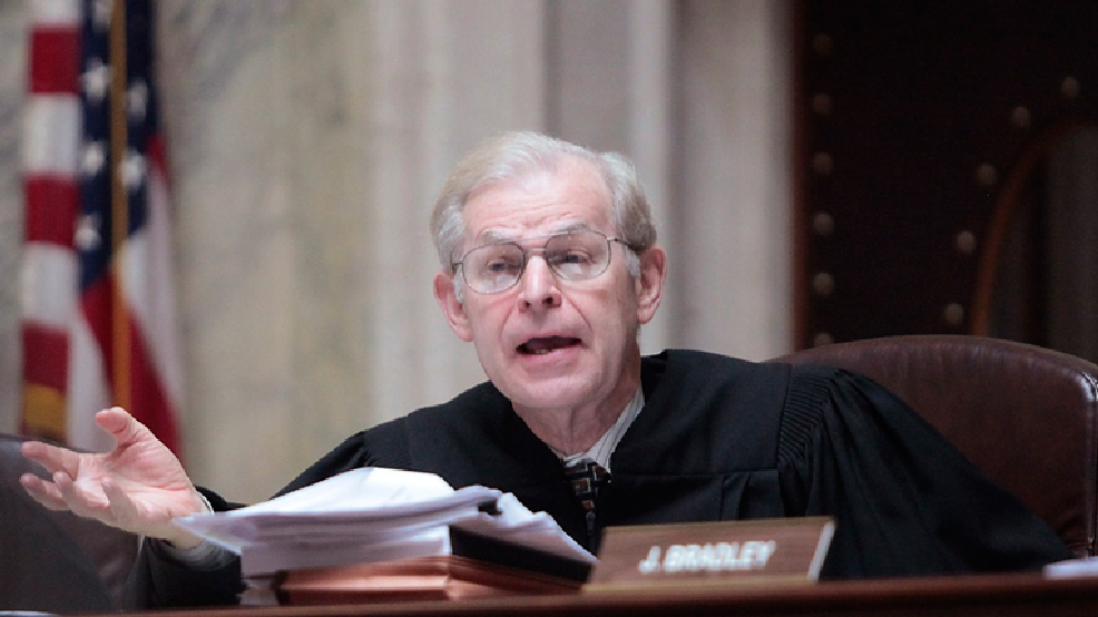 FILE - This June 6, 2011 photo shows Wisconsin Supreme Court Justice David Prosser posing a question to Dane County Circuit Court Representative Marie A. Stanton during a hearing at the Wisconsin State Capitol. (AP Photo/John Hart, Pool)